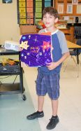 11 Showing off his Scrapbook Project